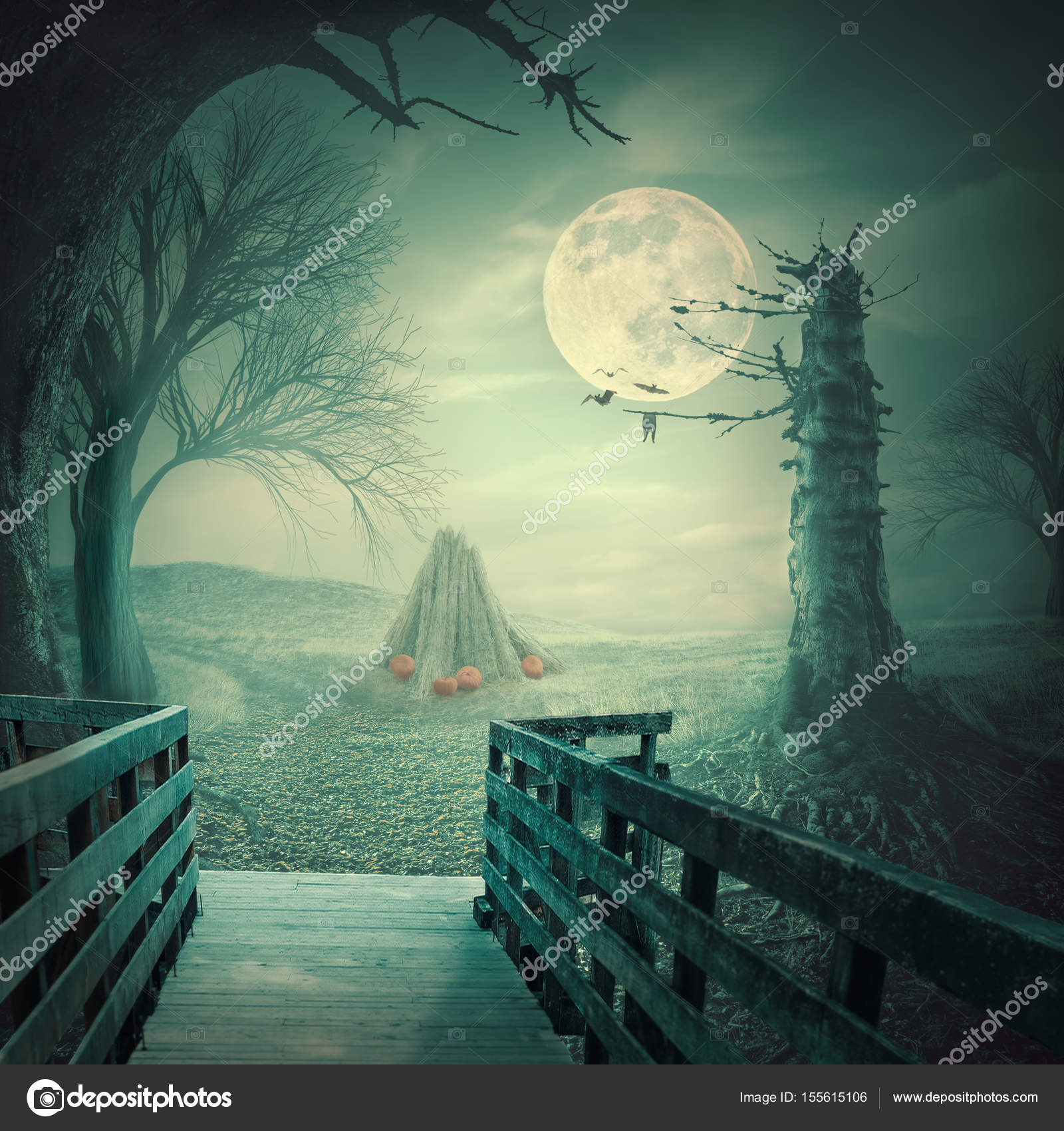 spooky halloween backdrop with pumpkins at straw stack stock photo