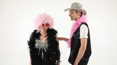 Fancy funny stylish happy silly couple friends having fun. Dance like nobodys watching. Happy party mood. White background video footage.