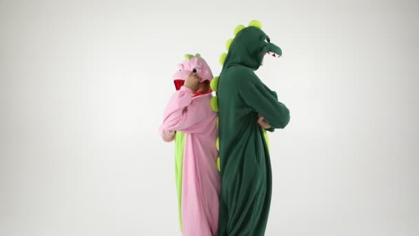 Dinosaur costumes absurd dancing couple. Funny party mood. White background video footage u2014 Stock & dinosaur costumes absurd dancing couple. Funny party mood. White ...