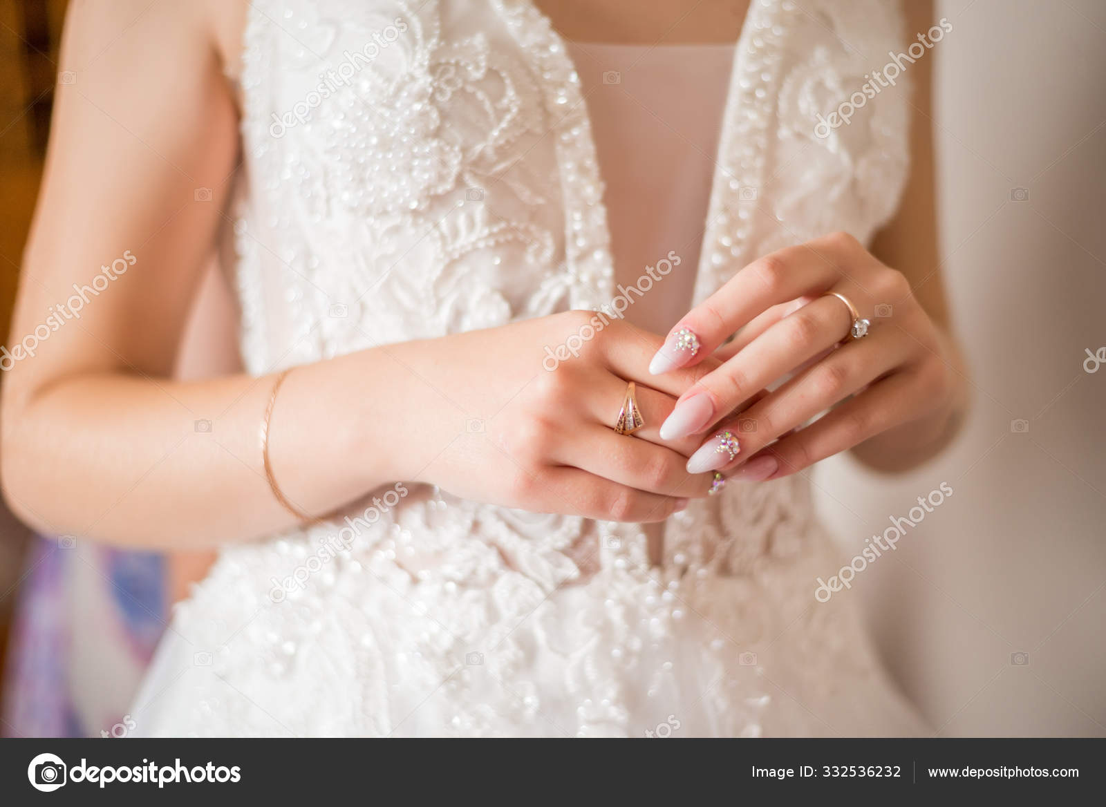 The Hands Of The Bride With Gold Wedding Ring With A Diamond Br