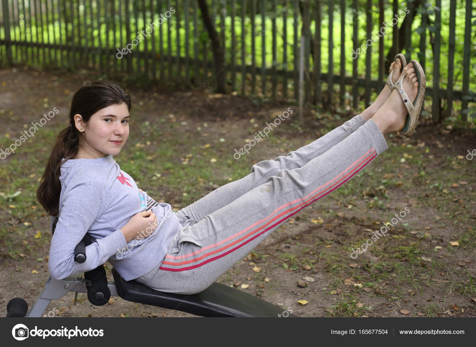 teenager girl work out abs on outdoor trainer close up summer photo photo by ulianna