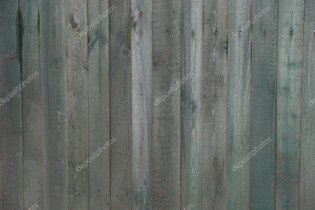colored dark wooden texture from old gray and green shabby boards in the fence wall
