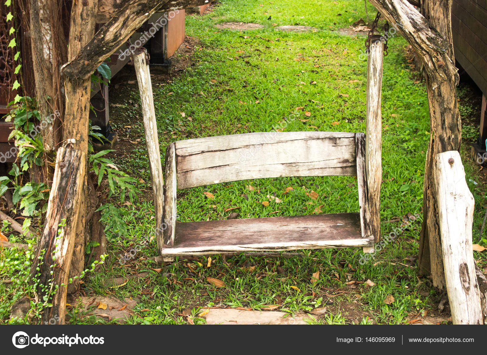 Awesome Wooden Porch Swing In Garden Stock Photo C Kaisorn4 146095969 Caraccident5 Cool Chair Designs And Ideas Caraccident5Info