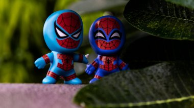 Selangor , Malaysia - March 28, 2019: Two McDonald's toy Spidermans having a conversation planning to do some pranks on the villain.
