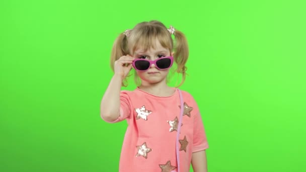 Positive girl in pink blouse and sunglasses dancing and posing. Chroma Key