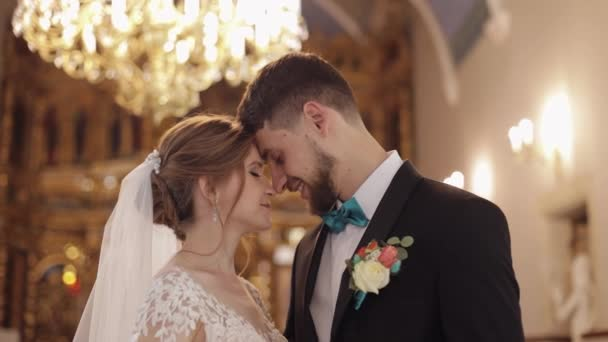 Newlyweds. Caucasian bride and groom together in an old church. Wedding