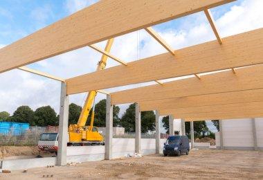on a building site wooden trusses are built on the concrete colu