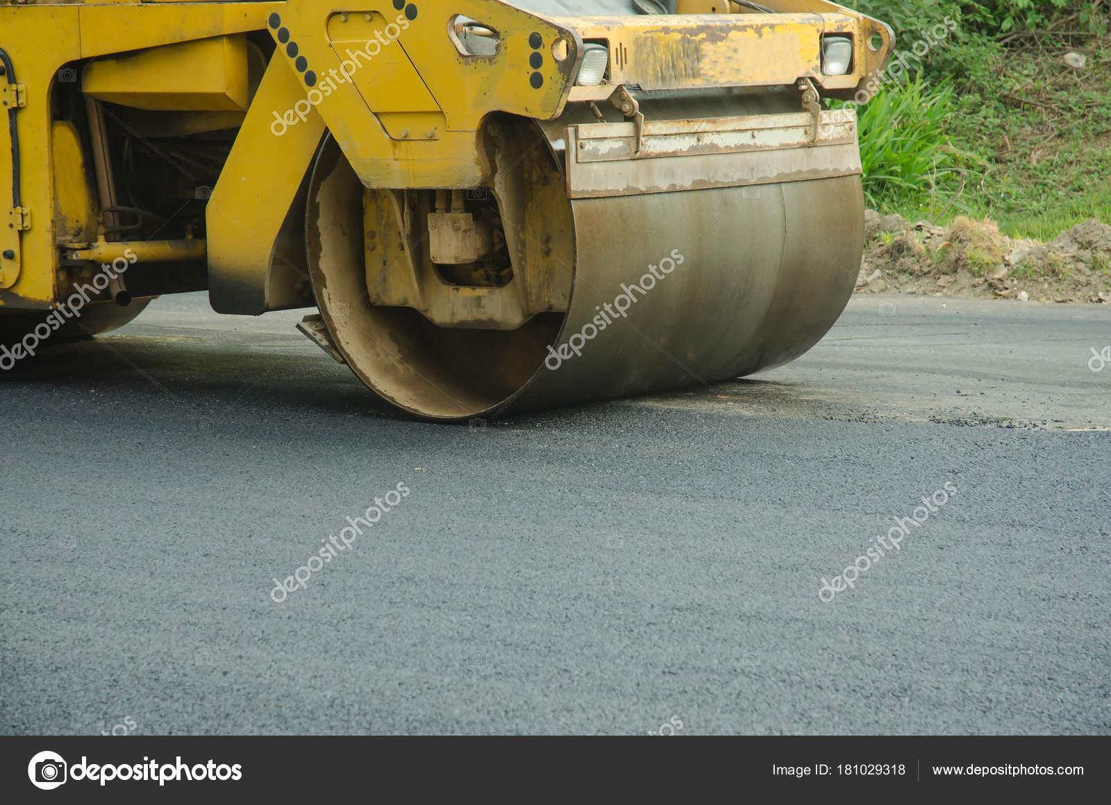 Road roller machine works asphalt road construction — Stock