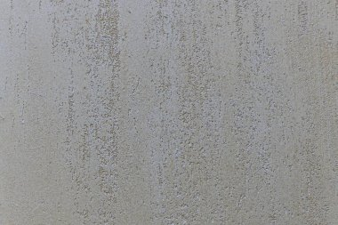 Beige with a mother-of-pearl neutral plaster background with rough recesses inside and a smooth structure outwards.