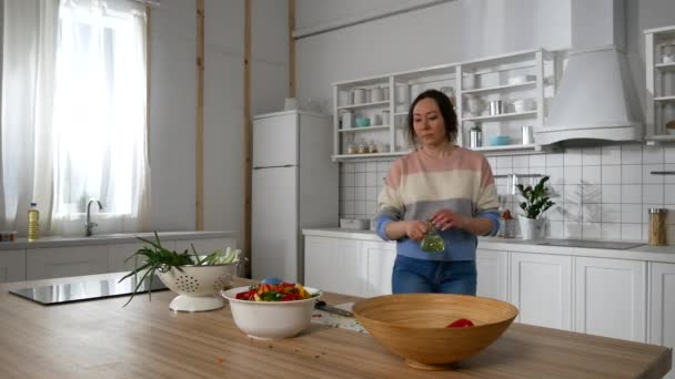 girl in the kitchen preparing a salad