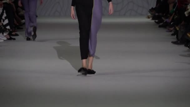 Girl model on the catwalk at fashion show
