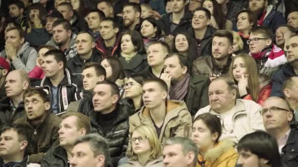 Fans during a hockey match. People spectators on the ice arena. Kyiv. Ukraine