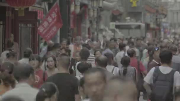 A crowd of people on the streets of the city. Beijing. China. Asia. Time lapse