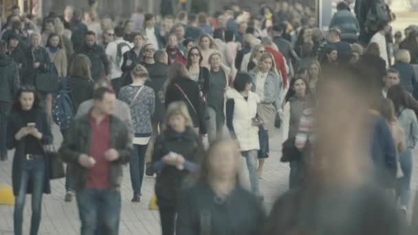 A crowd of people walking down the street. Slow motion. Kyiv. Ukraine