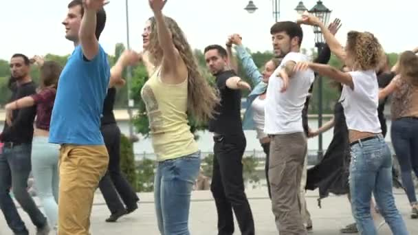 People couples dance Zuk dance in the city. Slow motion. Kyiv. Ukraine
