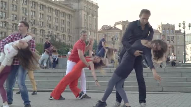 People couples dance Zuk dance in the city. Slow motion. Kyiv. Ukraine