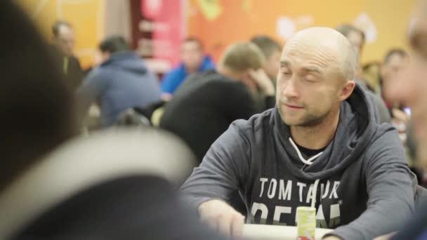 Playing poker in a casino. Gambling