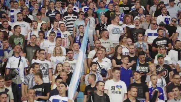 Fans at the stadium during the match. Slow motion. Olimpiyskiy. Kyiv. Ukraine.