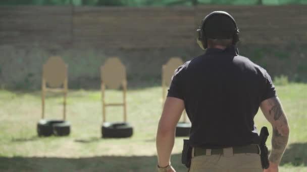 Man shooter shoots a pistol