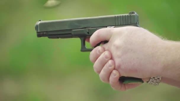 Close-up shot of a pistol. Slow motion.