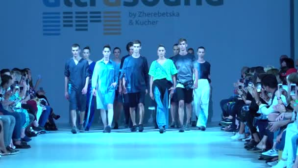 Fashion show. Group of models walking on the catwalk.
