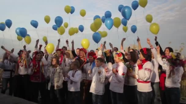 Ukrainians in national clothes with balloons. Kyiv. Ukraine.