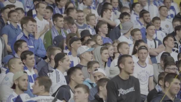 Fans at the stadium during the match. Slow motion. Olimpiyskiy. Kyiv. Ukraine.