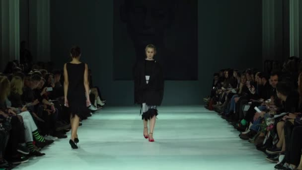 Fashion show. Woman model on the catwalk. Models. Slow motion