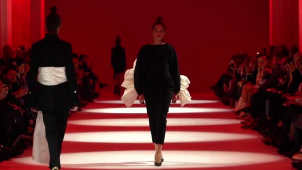 Fashion show. Model on the catwalk. Woman