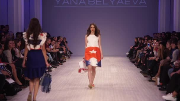 Woman model on the catwalk at fashion show