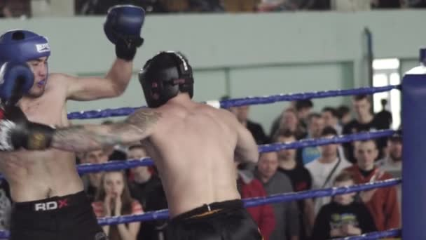 Kickboxing. The fight in the ring. Competition. Kyiv. Ukraine. Slow motion