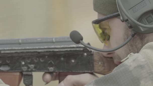 Rifle shooting. Slow motion. Close-up.