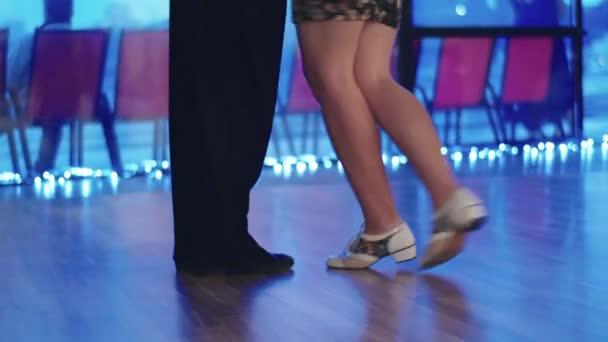 Tango dancers feet while dancing close-up