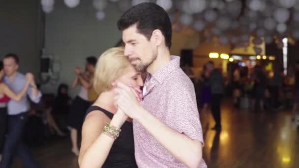 People dancers dance tango. Slow motion. Kyiv. Ukraine