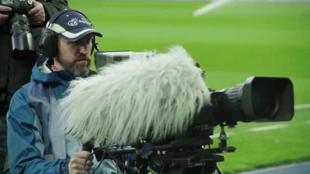 Cameraman with a camera in the stadium during a football match. TV