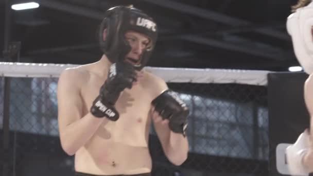 Fight in the MMA octagon. Slow motion. Kyiv. Ukraine