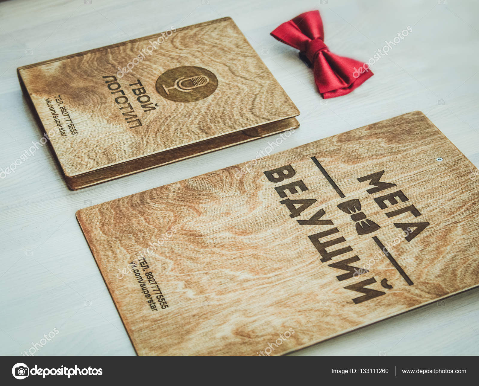 Stylish logo on a wooden tablet for the leading — Stock
