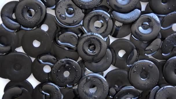 Ciambelle di pietra agata nera girare intorno