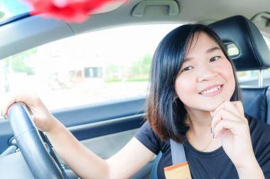 Asian beautiful women driving a car inside