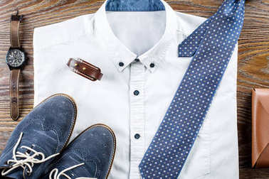 Mans classic clothes outfit flat lay with formal shirt, tie, shoes and accessories.