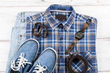 Mens casual outfit. Mens fashion clothing and accessories on white wooden background, flat lay