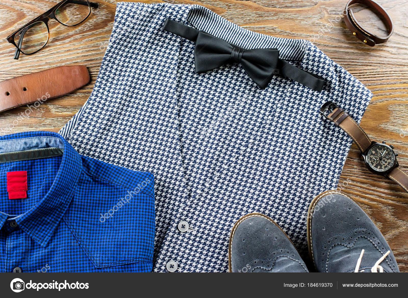 8cc7c54abfe1c Men clothes and accessories fashion set. Vest, bowtie, shirt, shoes on  wooden background.
