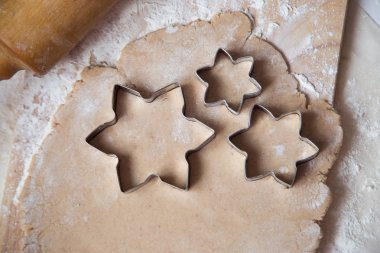 Dough beautiful cook cooking aesthetics. Celebration. New Year. Gingerbread, cookies. Crockery, recipe, kitchen. Cozy home cook at home eat home cooking utensils. Orange parchment. baking dish Moulds for cookies star puff pastry