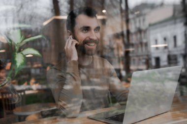 Adult bearded business man with laptop in cafe , modern digital technologies and fast internet.