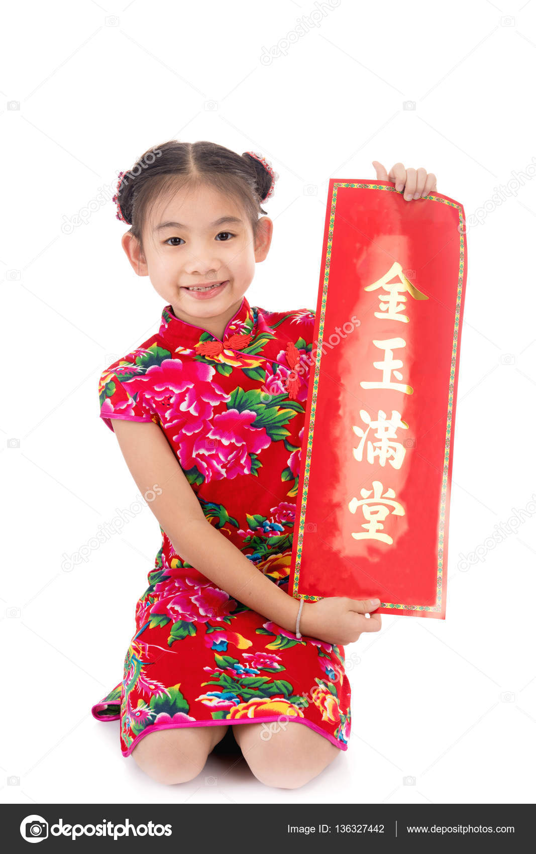 little asian girl showing chinese new year greetings stock photo