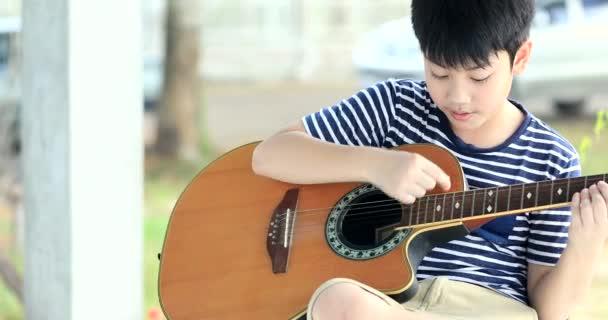 Asian boy guitar
