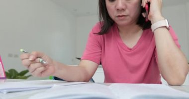 Young asian woman reading ,writing and talking concept .How to learning at home for test to masters degree .