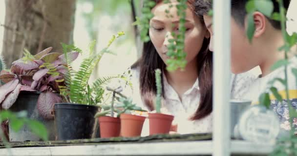 Young asian woman with boy learning and doing in garden.