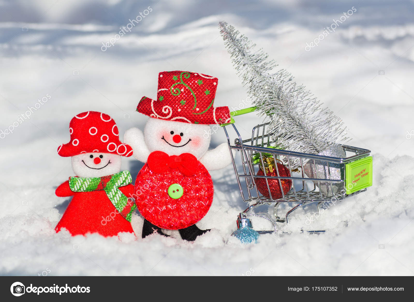 a pair of snowmen a husband and wife in a grocery cart drive a christmas tree and toys home merry christmas and happy new year photo by delfinkina