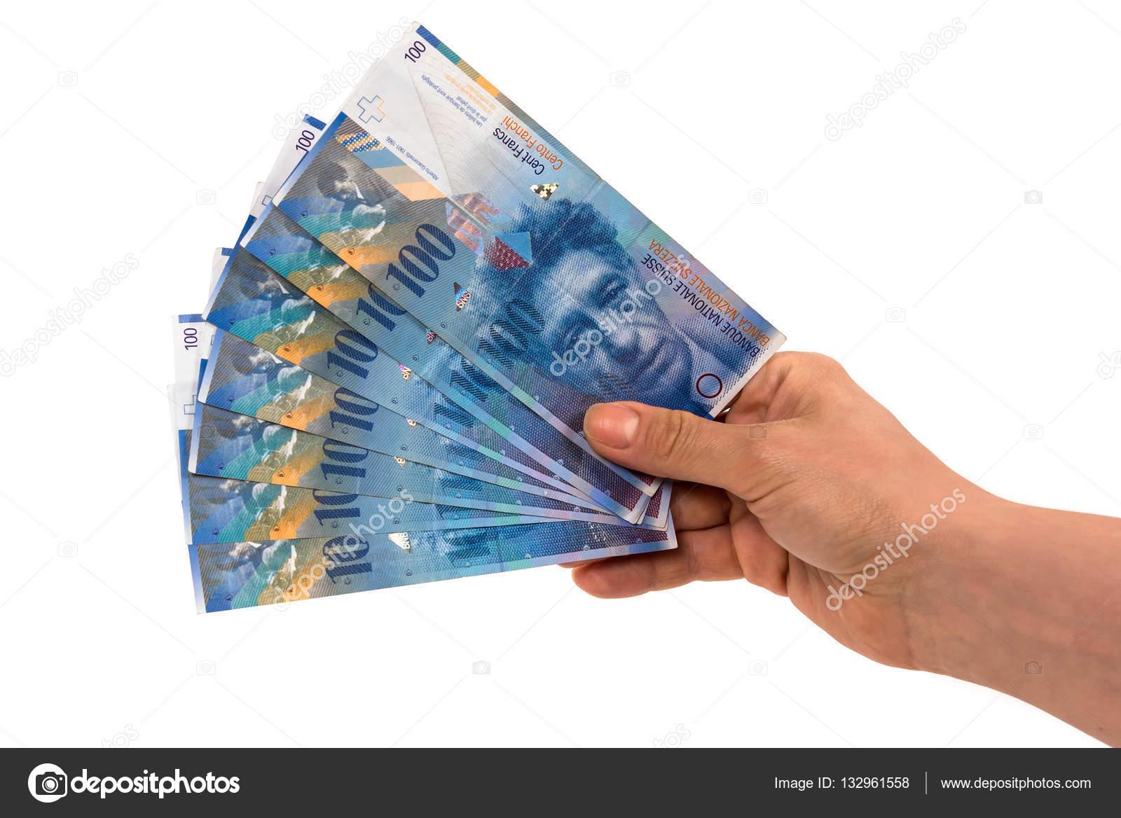 hand mit banknoten von 100 schweizer franken stockfoto mkos83 132961558. Black Bedroom Furniture Sets. Home Design Ideas